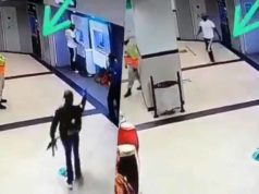 Watch how a security man run away after armed robbers took over a shop he was guarding (Video)