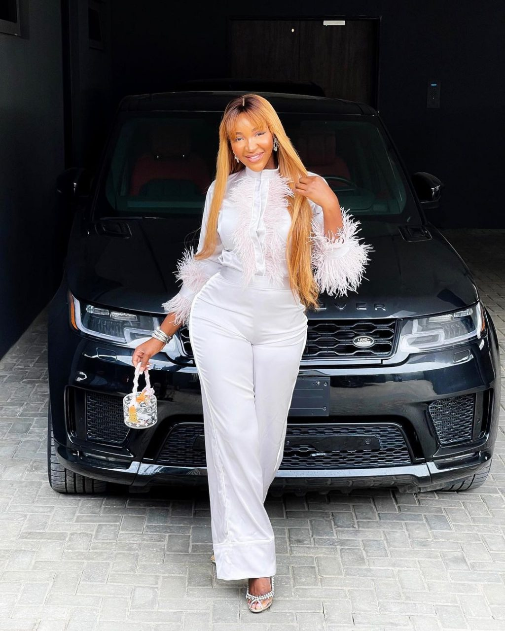 Renowned TV host, Idia Aisien receives a Range Rover from her siblings as a birthday gift